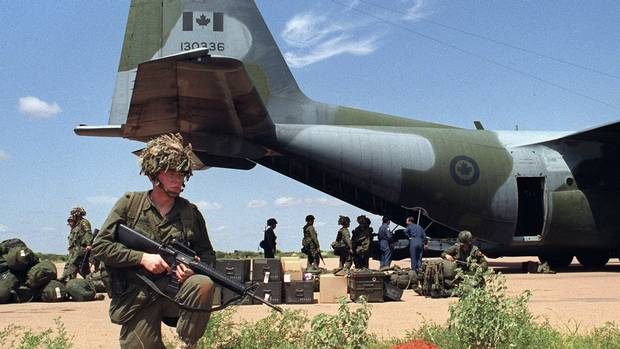Members of the Canadian Airborne Regiment get into position as they arrive to assume responsibility for the airport at Bali Dogle, Somalia, on December 15, 1992. Senior medical officials in the Canadian Forces say there is not enough scientific evidence to remove mefloquine as an option for troops who go to countries where malaria is a threat. (Andrew Vaughan/Canadian Press)