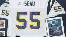 """A No.55 jersey is seen on display at Qualcomm Stadium as part of a """"Celebration of Life"""" memorial (Mike Blake/Reuters/Mike Blake/Reuters)"""