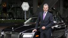 Torsten Muller-Otvos stands with a Rolls-Royce Ghost outside of the Ritz-Carlton in Toronto on Tuesday. (Matthew Sherwood for The Globe and mail)