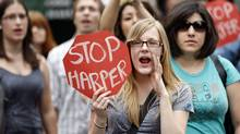 Anti-Harper demonstrators protest outside the Conservative Party convention in Ottawa on June 10, 2011. (Adrian Wyld/THE CANADIAN PRESS)