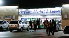 Police line up in front of the Ferguson Market & Liquor during a protest, following a release of previously undisclosed video of Michael Brown, in Ferguson, Missouri, U.S. on March 12, 2017. (Lawrence Bryant/REUTERS)