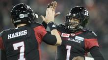 Ottawa Redblacks quarterback Henry Burris (1) celebrates a touchdown with Trevor Harris during third quarter CFL Grey Cup action Sunday, November 27, 2016 in Toronto. (Frank Gunn/THE CANADIAN PRESS)