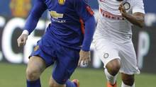 Manchester United's Wayne Rooney moves the ball as Inter Milan's Jonathan defends (Luis M. Alvarez/AP)