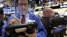 Trader Peter Costa works on the floor of the New York Stock Exchange. Economists are worried that the U.S. recovery may be stalling again. (Richard Drew/AP)