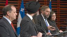 NDP federal leadership candidate Thomas Mulcair (second from right) responds to a question during an NDP leadership debate in Quebec City as Brian Topp (far left), Martin Singh (second from left) and Niki Ashton (right) look on. (Clemen Allard/The Canadian Press/Clemen Allard/The Canadian Press)