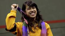 Malaysia's David Nicol shows the gold medal she won in the women's squash final at the 2010 Commonwealth Games (Manish Swarup/The Associated Press)