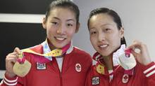 Michelle Li (left) was the gold medalist and Canadian teammate Joycelyn Ko took the silver in women's singles match at the 2011 Pan American Games in Guadalajara, Mexico on Thursday, Oct. 20, 2011. (Mike Ridewood/THE CANADIAN PRESS)