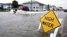 A car goes through the high water as Hurricane Sandy bears down on the east coast, Sunday, Oct. 28, 2012, in Ocean City, Md. (File photo) (Alex Brandon/AP Photo)