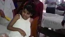 A young Indian girl sits on a bed in a hospital in this image taken from video in Bahraich, northern India, on April 6, 2017. Police are trying to identify the girl, who was found living with monkeys. (KK Productions/AP)