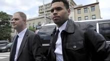 Singer Chris Brown arrives at the D.C. Superior Court, in Washington,Wednesday, June 25, 2014. Brown arrived for a hearing on the assault charge he faces. Brown was arrested and charged with misdemeanor assault in October, accused of hitting a man outside the W hotel. That man says Brown hit him after he tried to get in a photograph that the singer was taking with two women. (Susan Walsh/AP)