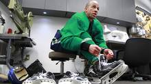 Manny Malhotra of the Vancouver Canucks tries on a new pair of skates after a team practice at Rogers Arena Tuesday. (Jeff Vinnick/The Globe and Mail/Jeff Vinnick/The Globe and Mail)