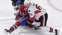 Montreal Canadiens' Gabriel Dumont (37) collides with Ottawa Senators' Andre Benoit (61) during first period NHL action in Montreal, Wednesday, March 13, 2013. (Graham Hughes/THE CANADIAN PRESS)