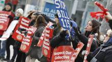 Ontario teachers march in protest in front of the Toronto District School Board offices on Dec. 18. (Peter Power/The Globe and Mail)