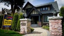 Home sales in the Vancouver region resale market rose by 37 per cent in April, compared to a year earlier as prices soared too, by 8.5 per cent for the year. The benchmark price of a detached home in the Greater Vancouver Area hit a record high of $1,002,200. (DARRYL DYCK For The Globe and Mail)