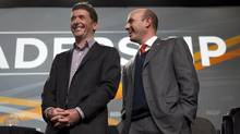 Federal NDP leadership candidates Paul Dewar, left, and Nathan Cullen talk before a town hall in Vancouver on Dec. 10, 2011. (RICHARD LAM/THE CANADIAN PRESS)