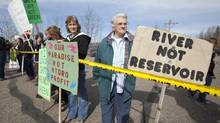 A small group of protesters stand at the airport in Hudson's Hope, B.C. Monday, April 19, 2010. They were protesting the announcement of the building of a new hydroelectric project named the Site C Clean Energy Project. Site C will use much of the same reservoir and will provide 900 megawatts of capacity and 4,600 gigawatt hours of electricity each year. (Jonathan Hayward/THE CANADIAN PRESS)