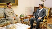 Newly appointed Egyptian Minister of Defence, Lieutenant.-General Abdel-Fattah el-Sissi, left, meets with Egyptian President Mohamed Morsi in Cairo on Aug. 13, 2012, the day after Mr. Morsi shook up the military by retiring some generals. (Egyptian Presidency/Associated Press)