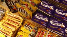 A file photo from January of 2010 of chocolate bars on a shelf at a store in central London. (SANG TAN/AP)