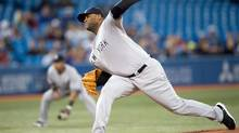 New York Yankees starting pitcher CC Sabathia (52) throws a pitch during the first inning in a game against the Toronto Blue Jays at the Rogers Centre. (Nick Turchiaro/USA Today Sports)