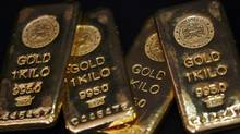 Gold bars are displayed at bullion house in Mumbai in this December 3, 2009 file photograph. (ARKO DATTA/REUTERS)