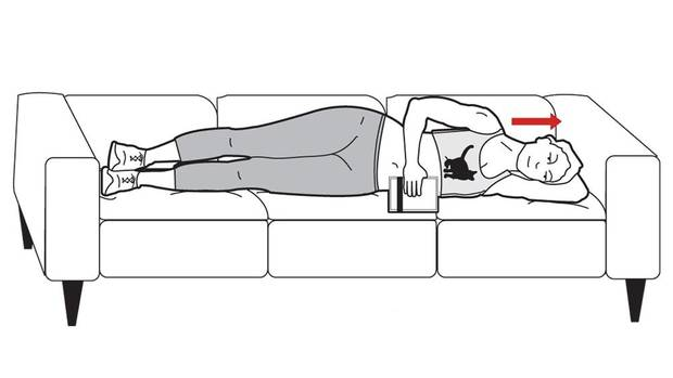 Lie on your side on the couch and put a pillow under your head, so that your neck is in line with your spine. Hold a light object in your top hand – a small book will work – and bend that arm at 90 degrees to your elbow. (Carrie Cockburn/The Globe and Mail)