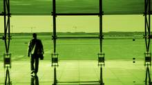 A business man walks through an airport terminal (eva serrabassa)