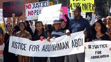 People assemble to honour Abdirahman Abdi in a protest at Ottawa's police headquarters on July 30, 2016. (FRED CHARTRAND/THE CANADIAN PRESS)