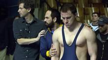 Director Bennett Miller, left, and stars Mark Ruffalo and Channing Tatum, who play wrestlers Dave and Mark Schultz. (Scott Garfield)