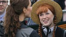 Kate, the Duchess of Cambridge, meets a girl dressed as the character, Anne of Green Gables, in Dalvay-by-the-Sea on Prince Edward Island as part of their Royal Tour of Canada, Monday, July 4, 2011. (Robert F. Bukaty/AP)