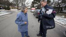 "Mail carrier Leo Gaspari talks with resident Liselotte ""Lotte"" Porschen, 69 as he delivers mail on his route in the Don Mills and Lawrence area in Toronto on Dec. 11, 12013. Canada Post, which announced last December it plans to phase out home delivery in favour of community mailboxes, is asking residents who can't physically get to their designated mailboxes to produce a certificate signed by a ""health-care professional."" (Deborah Baic/The Globe and Mail)"