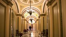 The corridor that leads to the floor of the U.S. House of Representatives is empty late Monday with no voting expected on a 'fiscal cliff' deal before the midnight deadline. (J. Scott Applewhite/AP)