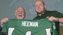 Jim Hopson, president and CEO of the Saskatchewan Roughriders (left) announce they will select U of S University of Saskatchewan Huksies offensive line Ben Heenan (right) first in the CFL draft later in the day during the 12th annual Dog's Breakfast at Prairie Land Park in Saskatoon, Sask., Thursday (Liam Richards/Liam Richards/The Canadian Press)