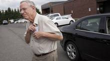 Edward Burkhardt, chairman of Montreal, Maine & Atlantic Railway, leaves the provincial police station in Lac-Mégantic, Que., on June 10, 2013. (MOE DOIRON/THE GLOBE AND MAIL)