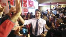 Liberal Leader Justin Trudeau greets supporters while arriving at a campaign rally in Ottawa, Oct. 12, 2015. (CHRIS WATTIE/REUTERS)