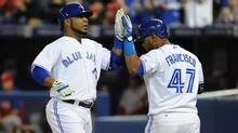 Toronto Blue Jays first baseman Edwin Encarnacion (left) is greeted by third baseman Juan Francisco after hitting a second inning home run against Philadelphia Phillies at Rogers Centre. (Dan Hamilton/USA Today Sports)