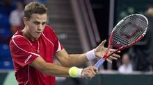 Canada's Vasek Pospisil hits a return to Italy's Andreas Seppi during the quarter final singles match of the Davis Cup tennis tournament in Vancouver, British Columbia April 5, 2013. (BEN NELMS/REUTERS)