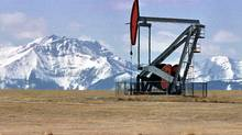 A pumpjack sucks oil out of the ground in a serene setting near Longview, Alberta (JEFF MCINTOSH/GLOBE AND MAIL)