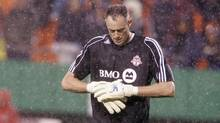 Toronto FC goalkeeper Greg Sutton adjusts his gloves during a driving rainstorm at a soccer game against the Kansas City Wizards, Wednesday, April 25, 2007, in Kansas City, Mo (Associated Press)