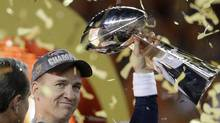 In this Sunday, Feb. 7, 2016 photo, Denver Broncosí Peyton Manning holds the Lombardi Trophy after the NFL Super Bowl 50 football game against the Carolina Panthers in Santa Clara, Calif. (Ben Margot/AP)