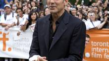 Actor George Clooney arrives to the red carpet for the gala screening of 'The Men Who Stare At Goats' during the Toronto International Film Festival at Roy Thomson Hall in Toronto, Ontario Friday September 11, 2009. (Sean Kilpatrick/The Canadian Press)
