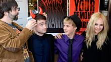 Joe Hill puts a plastic set of horns on Daniel Radcliffe at the Horns premiere during the 2013 Toronto International Film Festival on Friday. (Aaron Harris/Getty Images)