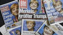 Monday's German newspapers trumper Angela Merkel's victory, but she still needs to select a coalition partner and decide on a legacy. (Ferdinand Ostrop/AP)