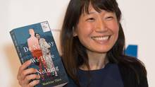 Canadian author Madeleine Thien poses for a photograph at a photocall in London on October 24, 2016. (DANIEL LEAL-OLIVAS/AFP/Getty Images)