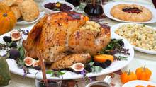 Dinner table with roasted Thanksgiving turkey. (evgenyb/iStockphoto)