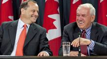NDP leadership hopeful Brian Topp shares a laugh with former leader Ed Broadbent at an Ottawa news conference on Sept 12, 2011. (FRED CHARTRAND/THE CANADIAN PRESS)