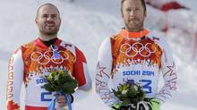 The United States' Bode Miller stands on the podium during a flower ceremony at the Sochi 2014 Winter Olympics, Sunday, Feb. 16, 2014, in Krasnaya Polyana, Russia. (Christophe Ena/AP)