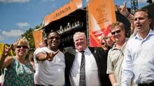 Toronto Mayor Rob Ford, centre, and a delegation of Austin and Toronto government and industry officials get a tour of the Austin City Limits music festival at Zilker Park in Austin, TX on Fri., Oct. 3, 2013. The cities of Toronto and Austin recently passed resolutions to create a Music City Alliance. (Ashley Landis for The Globe and Mail)