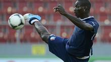 Italy's soccer player Mario Balotelli controls the ball during a training session during the Euro 2012 in Krakow June 20, 2012. (NIGEL RODDIS/REUTERS)