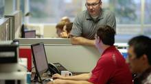 Brent McPhail, a partner in Brave Control Solutions, talks with employees. (GEOFF ROBINS For The Globe and Mail)