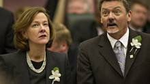 Alberta Premier Alison Redford and Deputy Premier and President of the Treasury Board Doug Horner look to the visitor stands during the Speech from the Throne at the Alberta Legislature in Edmonton on Tuesday Feb. 7, 2012. (JASON FRANSON/THE CANADIAN PRESS)